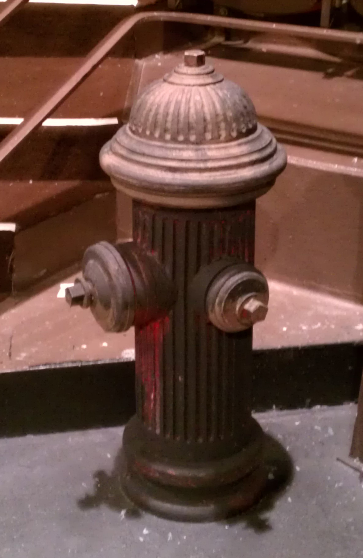 The finished fire hydrant onstage under work lights.